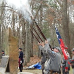 Reenactors fire a salute to the fallen soldiers of the battle.